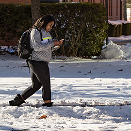 student walking on campus