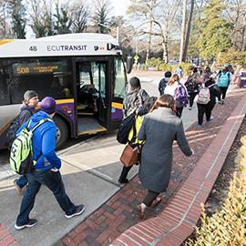Students exit an ECU Transit bus