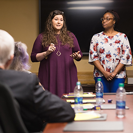 ECU students in the School of Social Work discuss their program with members of the HHP Advancement Council
