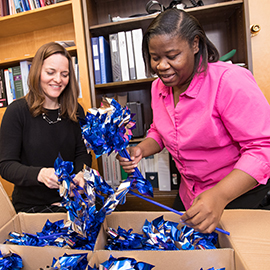 Mental Health Therapist Wendy Shouse, left, and Family Advocate Latoya Mobley sort through pinwheels at the TEDI BEAR Children's Advocacy Center. The center plants the pinwheels along sidewalks to promote Child Abuse Prevention month in April every year.
