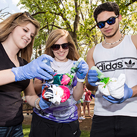 Event-goers tie-dye T-shirts at Barefoot on the Mall