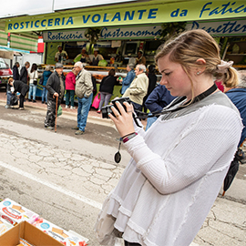 A student takes photos in Italy during the Italy Intensives study abroad program.