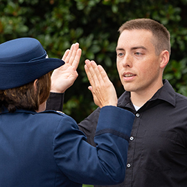 David Sager is commissioned in the Air Force at the fountain on campus.