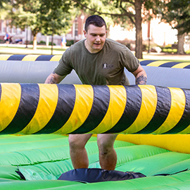 A student participates in the Homecoming Cannonball event on the mall.