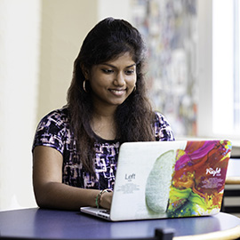 Pranaya Pakala works on her computer in Joyner Library.