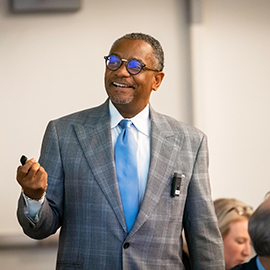 Dr. James Johnson, director of the Urban Investment Strategies Center in the Kenan-Flagler Business School at UNC-Chapel Hill, presents during the third annual Unified Quality Improvement Symposium at the East Carolina Heart Institute.