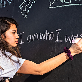 The S.H.O.E.S. Project, or Students Honoring Others' Everyday Struggles, raises awareness of mental health issues and informs students of available resources. Students write motivational messages on the board during the event.
