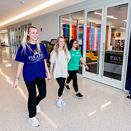 Students walk in a hallway in the new Main Campus Student Center, which opened at the beginning of January.