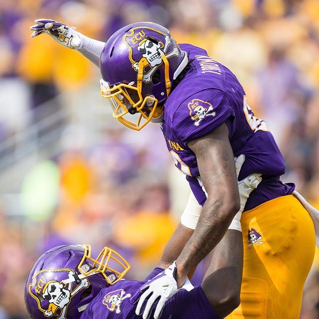 Outside linebacker Brandon Smith hoists wide receiver Trevon Brown in the air to celebrate Brown's touchdown run against Virginia TechOutside linebacker Brandon Smith hoists wide receiver Trevon Brown in the air to celebrate Brown's touchdown run against Virginia Tech. (ECU photo by Cliff Hollis)