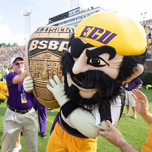 PeeDee the Pirate lifts a replica of a ring from the ECU Official Ring Collection during the Virginia Tech game. The ring was revealed to the public for the first time at the game. (ECU photo by Cliff Hollis)