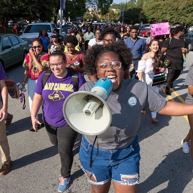 ECU students make their way up College Hill as they participate in an NAACP Unity March on Wednesday. The goal of the march was to show unification. (ECU Photo by Rhett Butler)