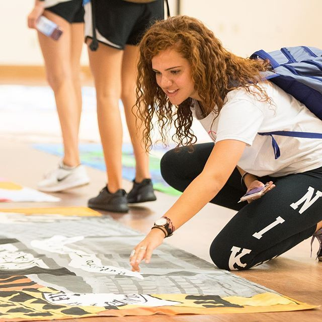 Homecoming banners are viewed and judged during the banner competition in Mendenhall Student Center. The banners are part of homecoming football activities all week. (ECU Photo by Cliff Hollis)